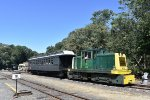 USS Tonner # 45 and the enclosed restored CN Central coach sit in a consist.