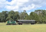 USS Tonner # 45 pulling its restored enclosed CN Coach alongside a street running through Allaire State Park
