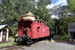 Restored CNJ Caboose bringing up the rear of its train on the Pine Creek Railroad