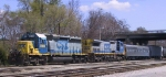 CSX 8106 & 7778 plus a passenger car are on the point of a train