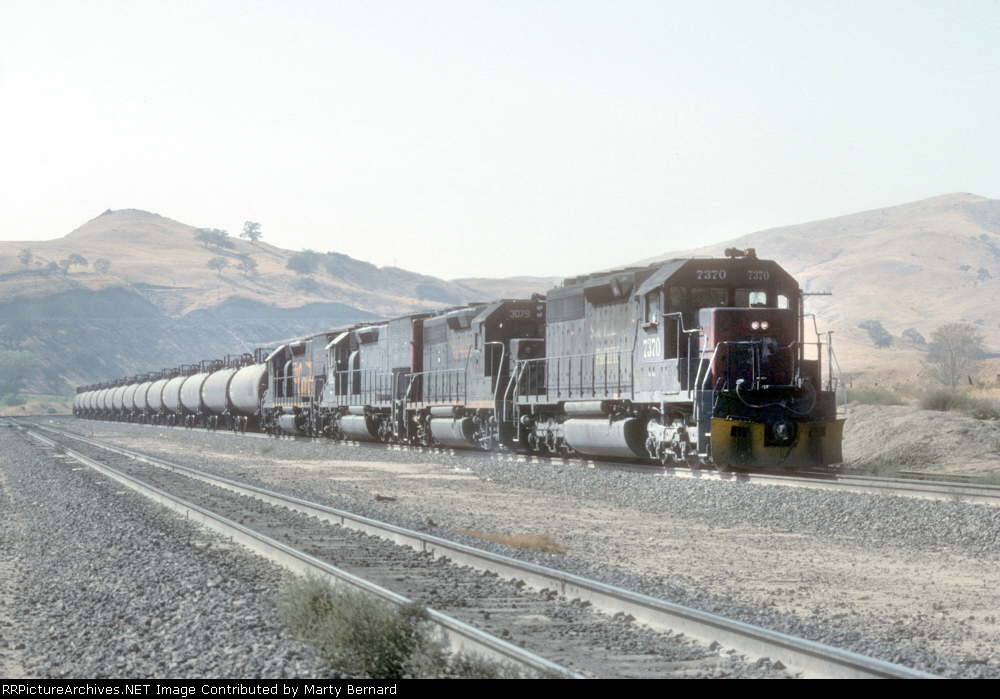 "A Mix of EMD 40-series Ready to Pull ""Cans"" Up the Hill"