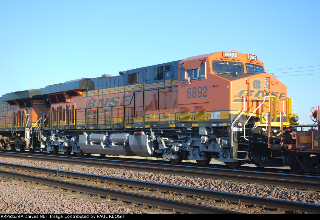 BNSF 7461 leads a Very Brand New BNSF 6892 as the sun reflects off their BNSF Swoosh Logo Paint.