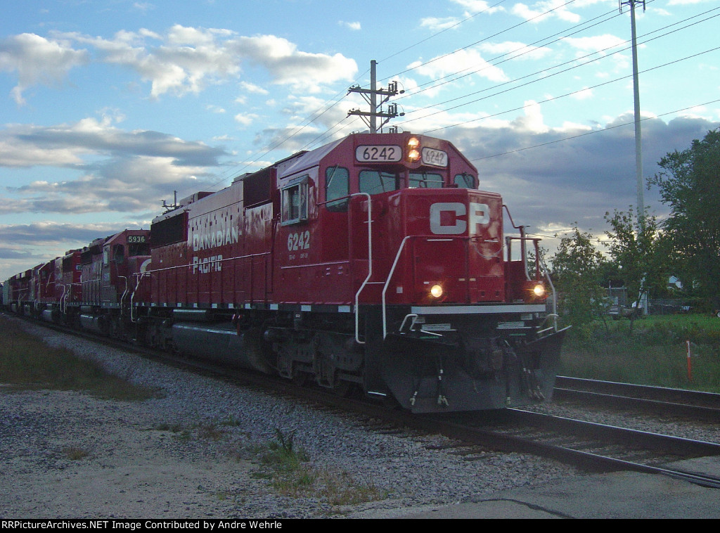 CP 6242 heads up five six-axle motors, 3 EMD and 2 GE on 281