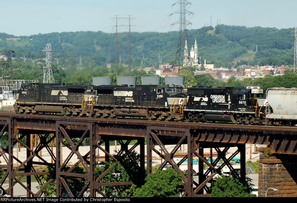 NS 9-40CW 9958, 9396 & GP38-2 5670 lead 36A across the OC bridge