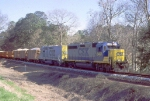 CSX 6457 with a ballast train
