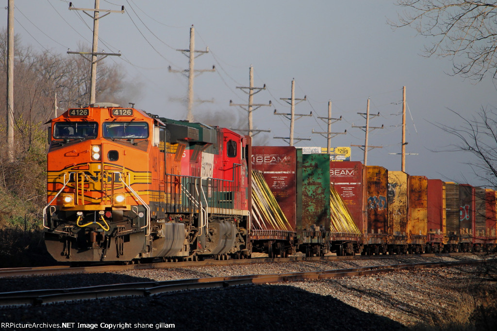 BNSF 4126 leads the galmem sb with fxe power.