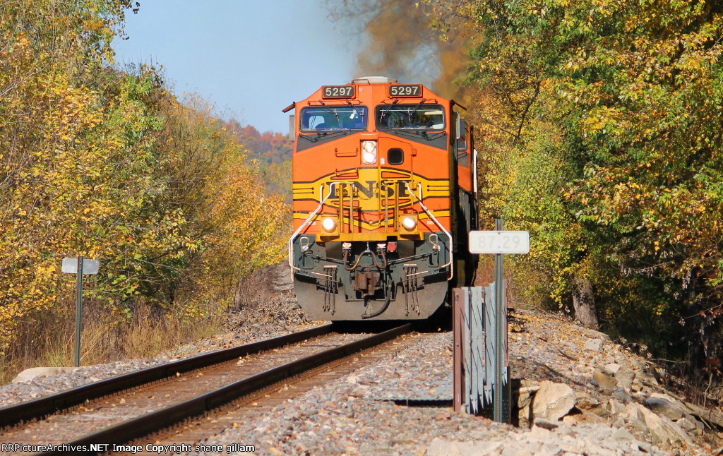 BNSF 5297 leads a mixed freight sb.